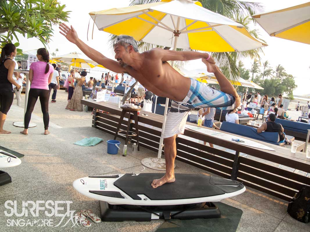 Surfset Soulscape 2014 man in yoga pose on board
