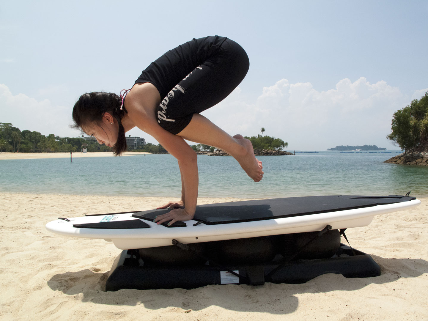 Shuyi in Yoga Crow Pose on Surfset Board at Sentosa