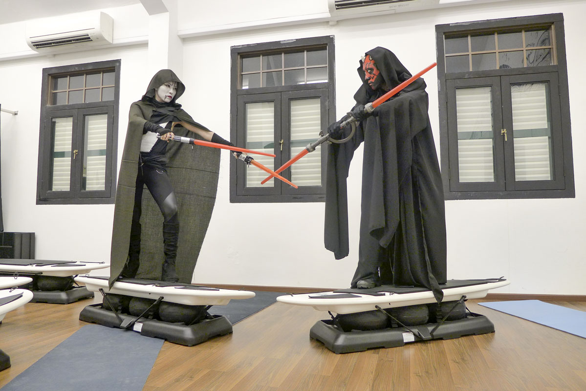 Halloween Darth Maul and Assaj Ventress combat in Surfset Studio