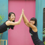 Shuyi and Nat doing Yoga Moves in Katong
