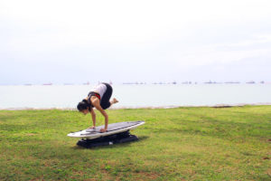 Shuyi Crow Pose on SURFSET board